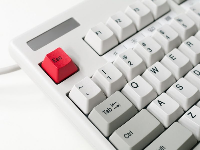 old computer keyboard red escape button finance